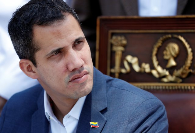 Venezuelan opposition leader Juan Guaido, who many nations have recognized as the country's rightful interim ruler, attends a news conference in Caracas